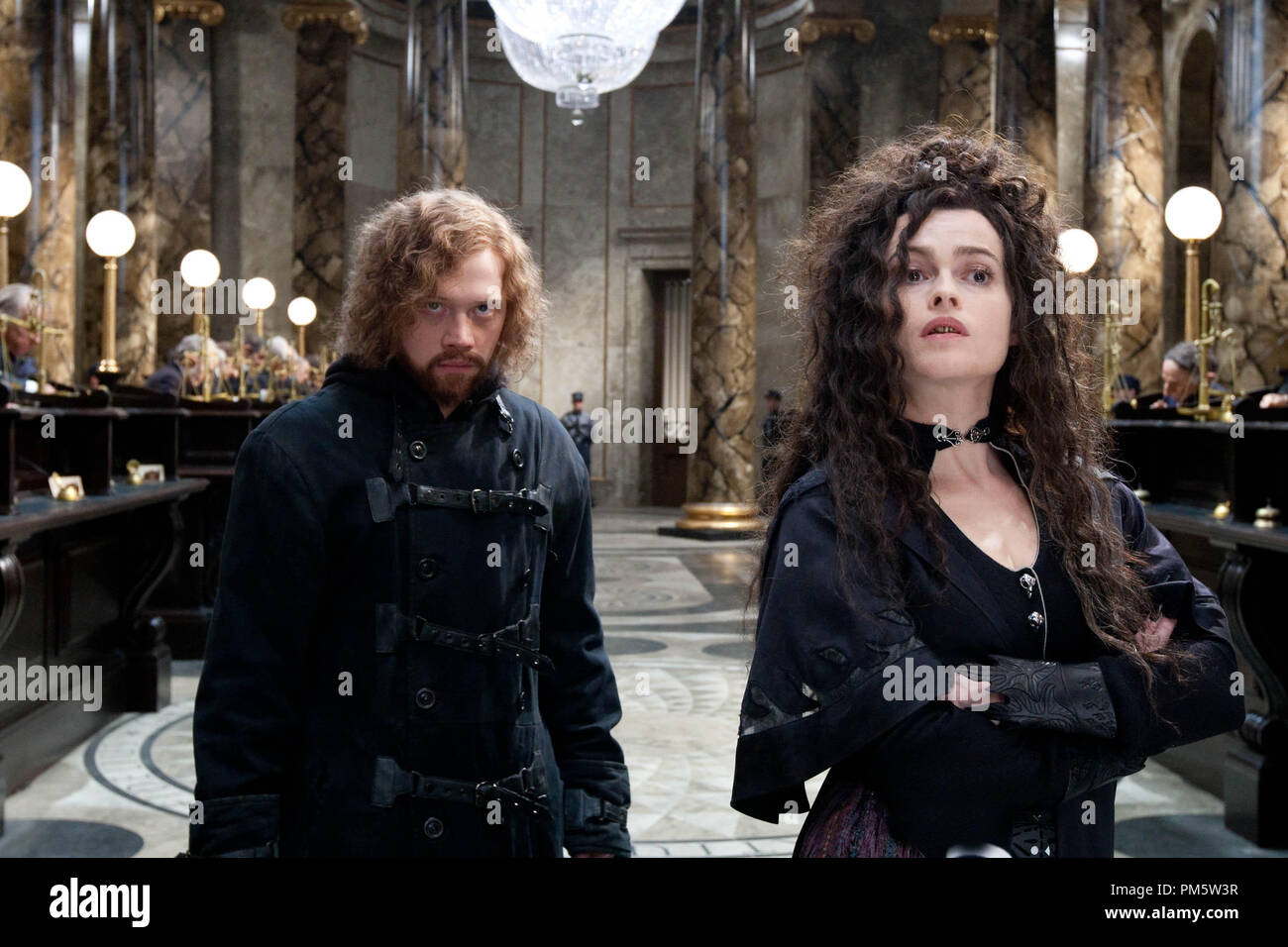 """(L-r) RUPERT GRINT as Ron Weasley and HELENA BONHAM CARTER as Bellatrix Lestrange in Warner Bros. Pictures' fantasy adventure """"HARRY POTTER AND THE DEATHLY HALLOWS – PART 2,"""" a Warner Bros. Pictures release. - Stock Image"""
