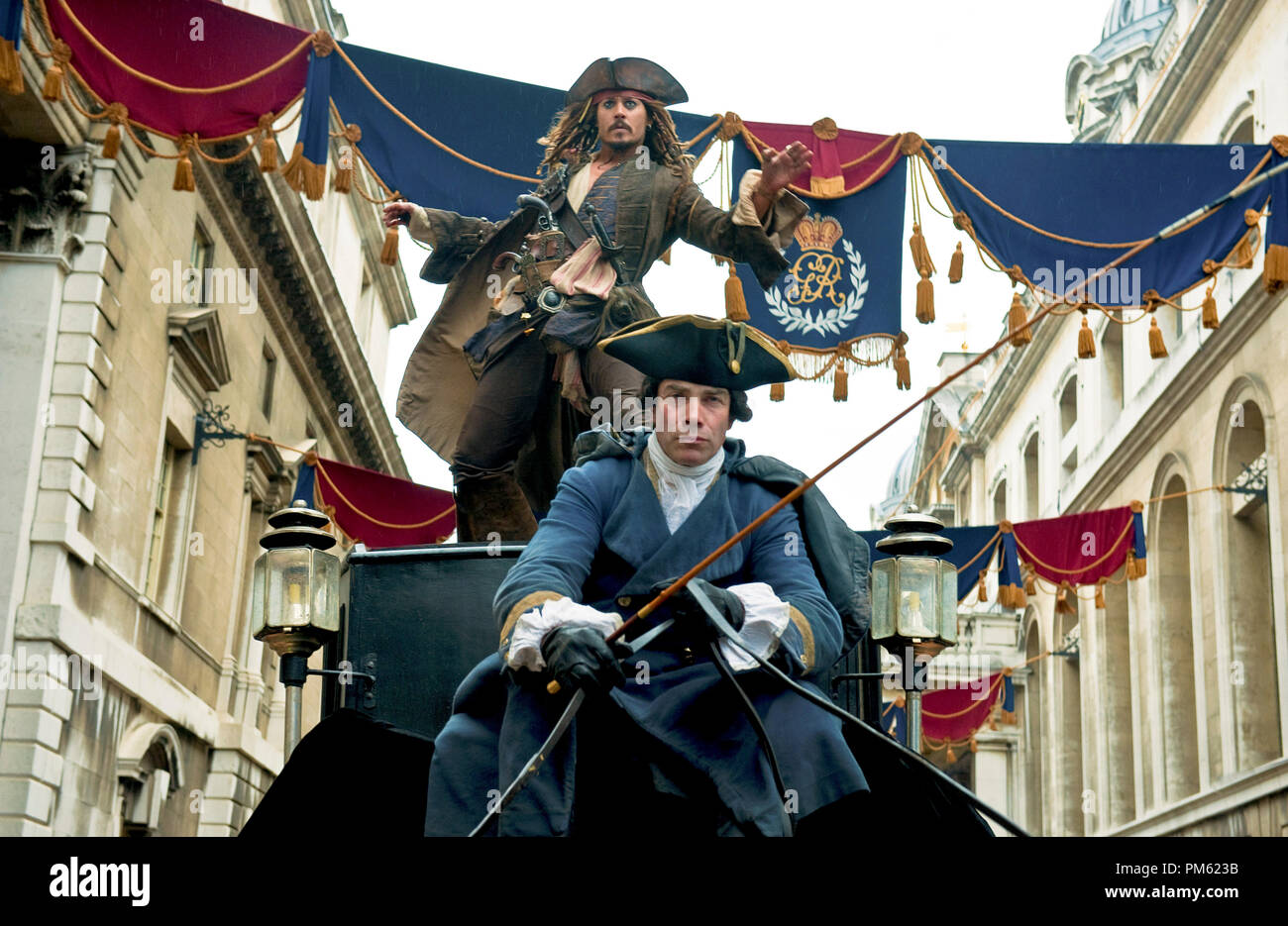 'PIRATES OF THE CARIBBEAN: ON STRANGER TIDES' Captain Jack (JOHNNY DEPP) escapes from the clutches of King George and his Royal Guards by leaping from carriage to carriageÉwhile theyÕre still moving! - Stock Image