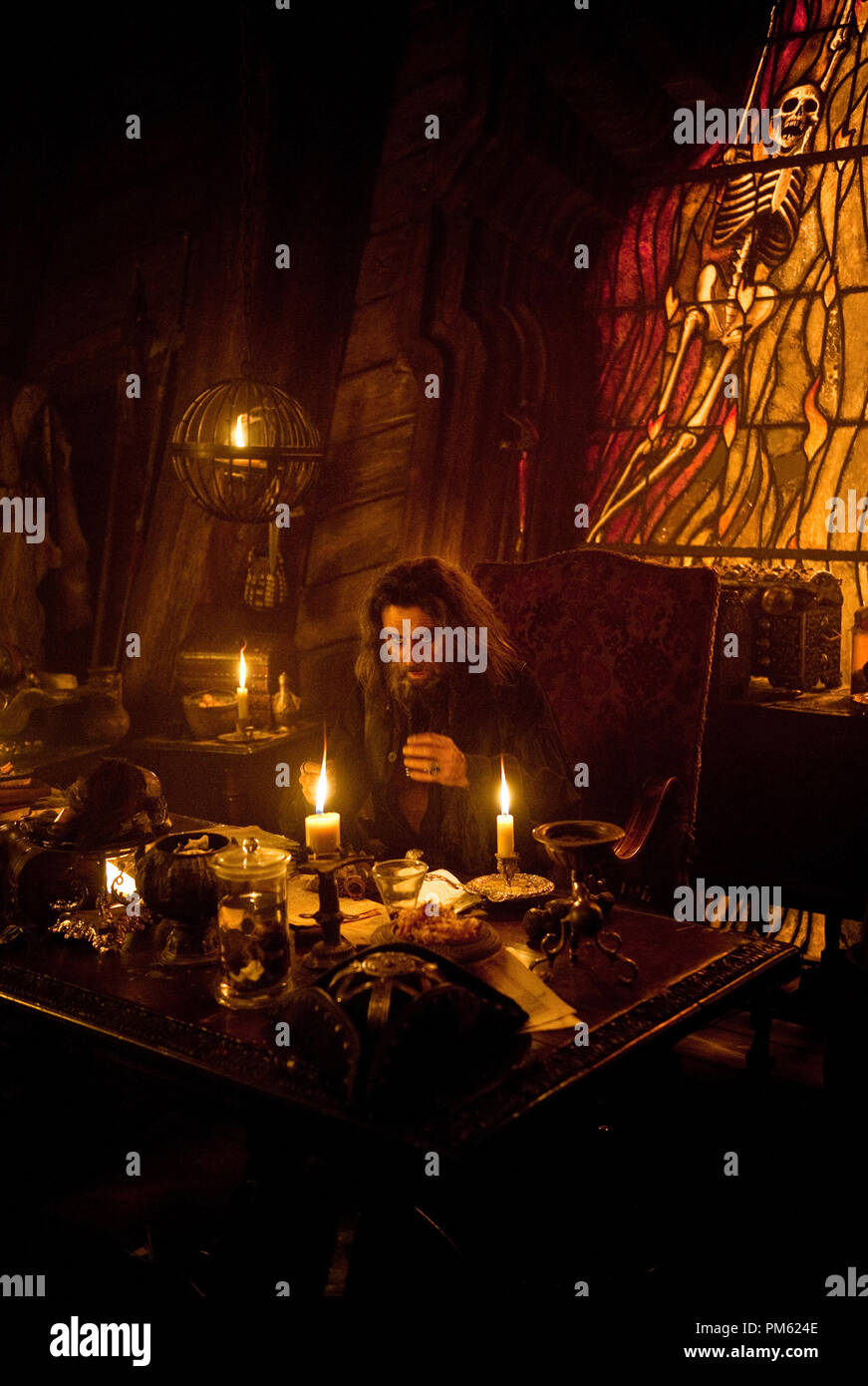 """PIRATES OF THE CARIBBEAN: ON STRANGER TIDES"" Blackbeard (IAN McSHANE) at  work on the dark arts in the sinister captain's cabin of the Queen Anne's  Revenge."