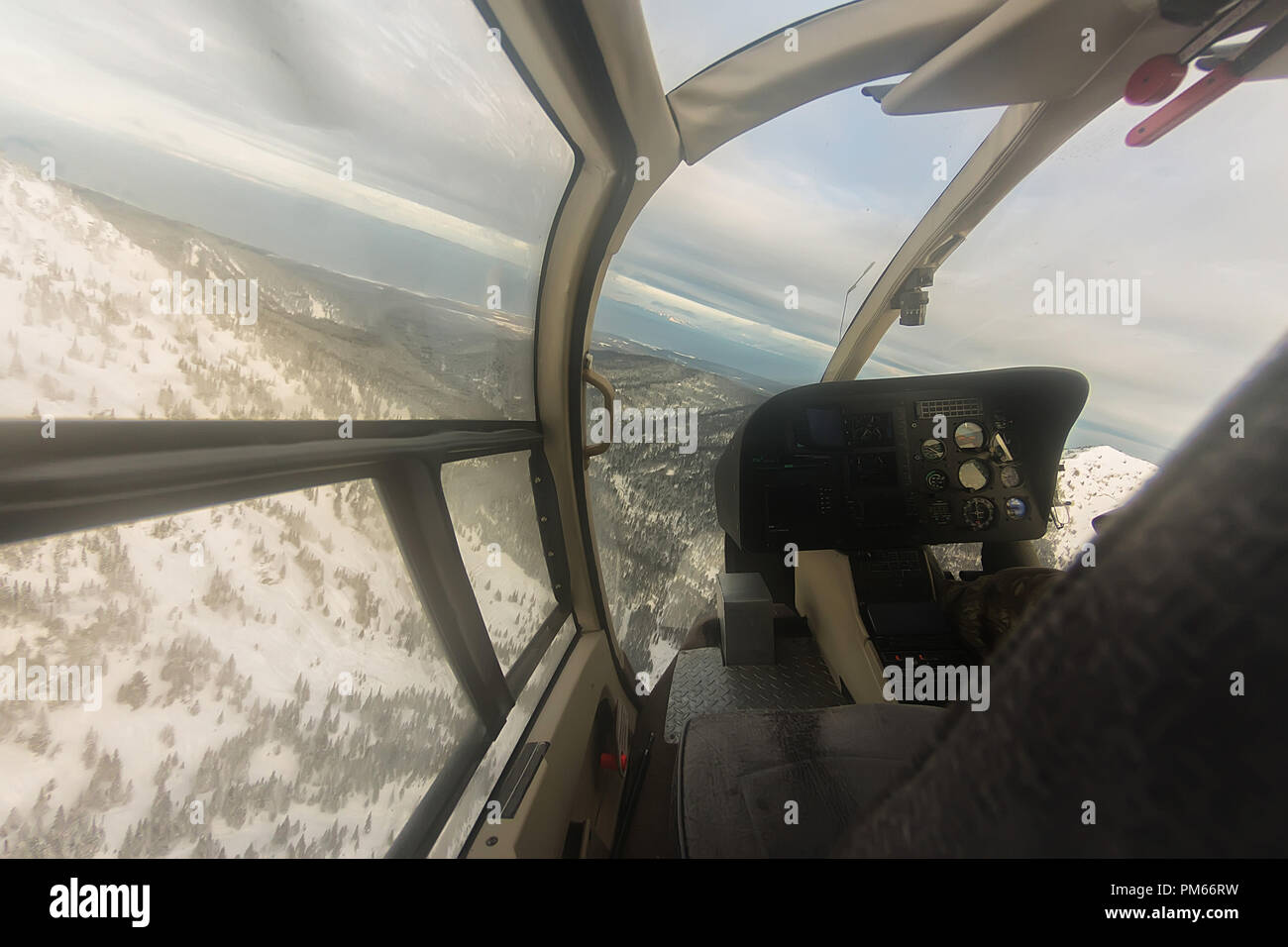 Cabin helicopter view of the snowy mountains freeride heliski. - Stock Image