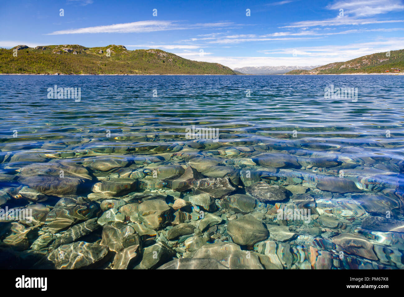 Crystal clear water of Lake Mosvatn (Mosvann) in Telemark County, Norway - Stock Image
