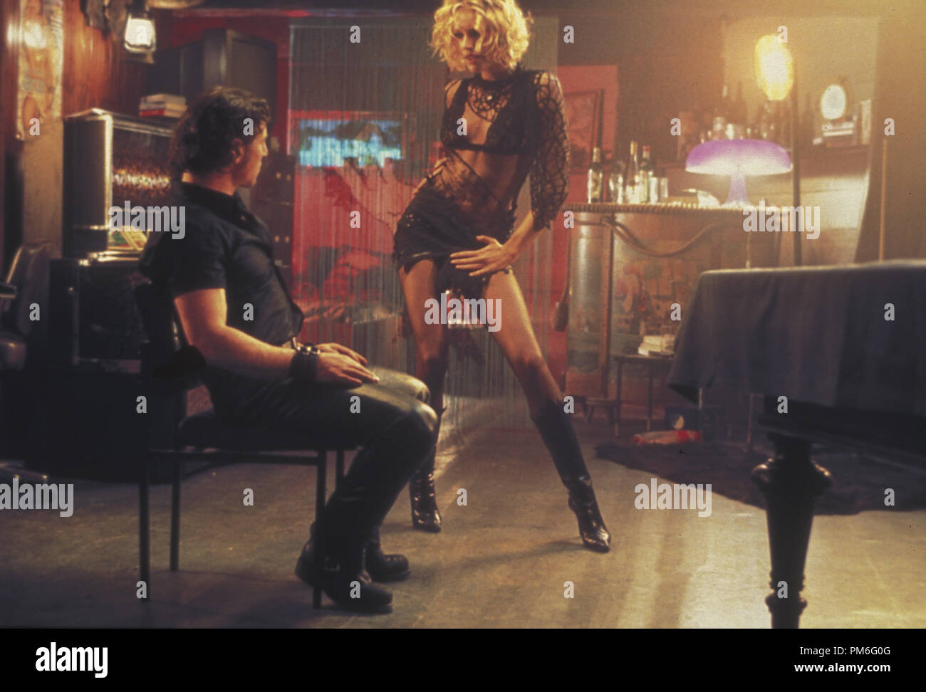 Rebecca romijn and rie rasmussen lesbo scene in femme fatale movie new foto