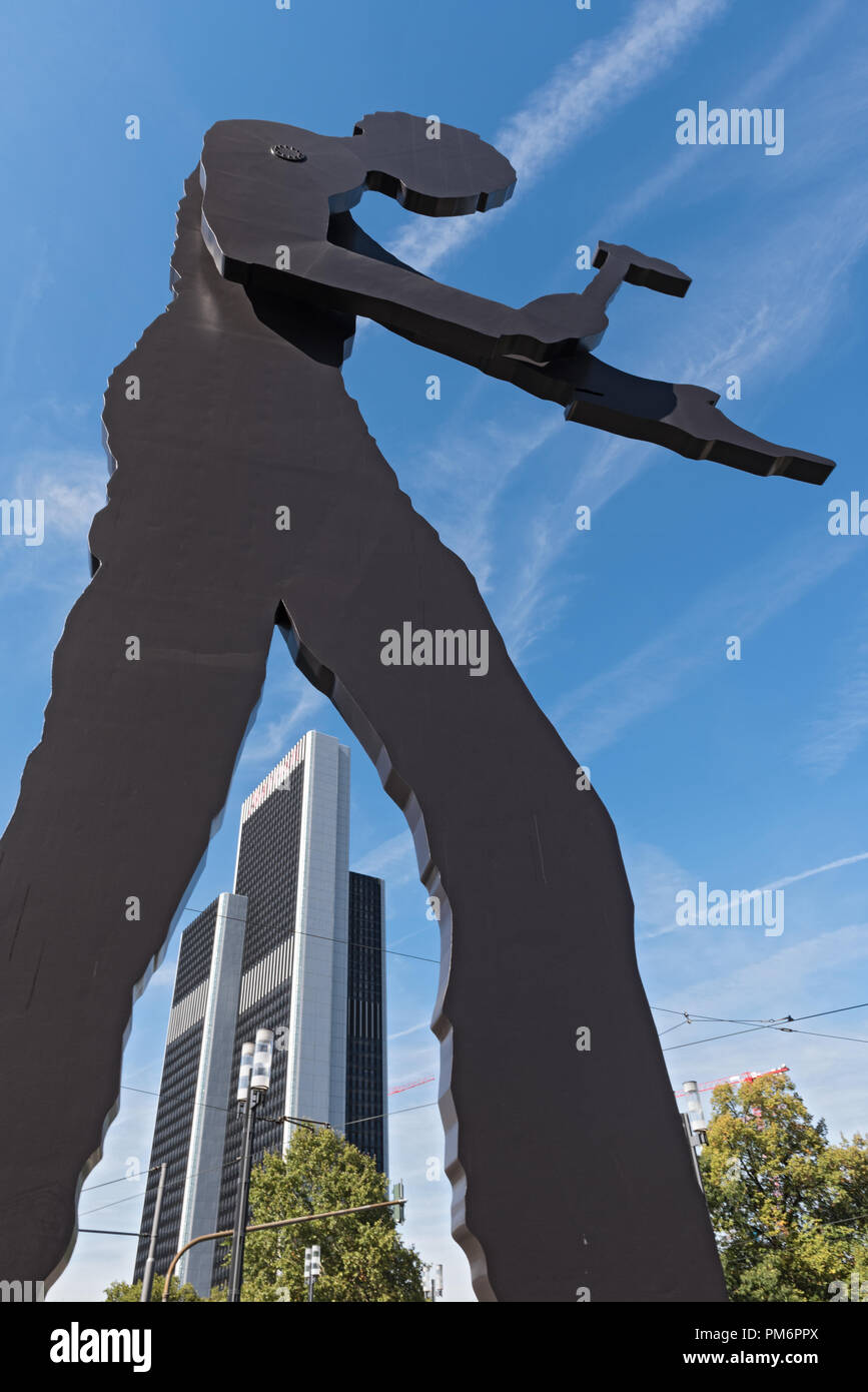 the sculpture, hammering man, designed by jonathan borofsky, near frankfurt exhibition area, frankfurt am main, germany. Stock Photo