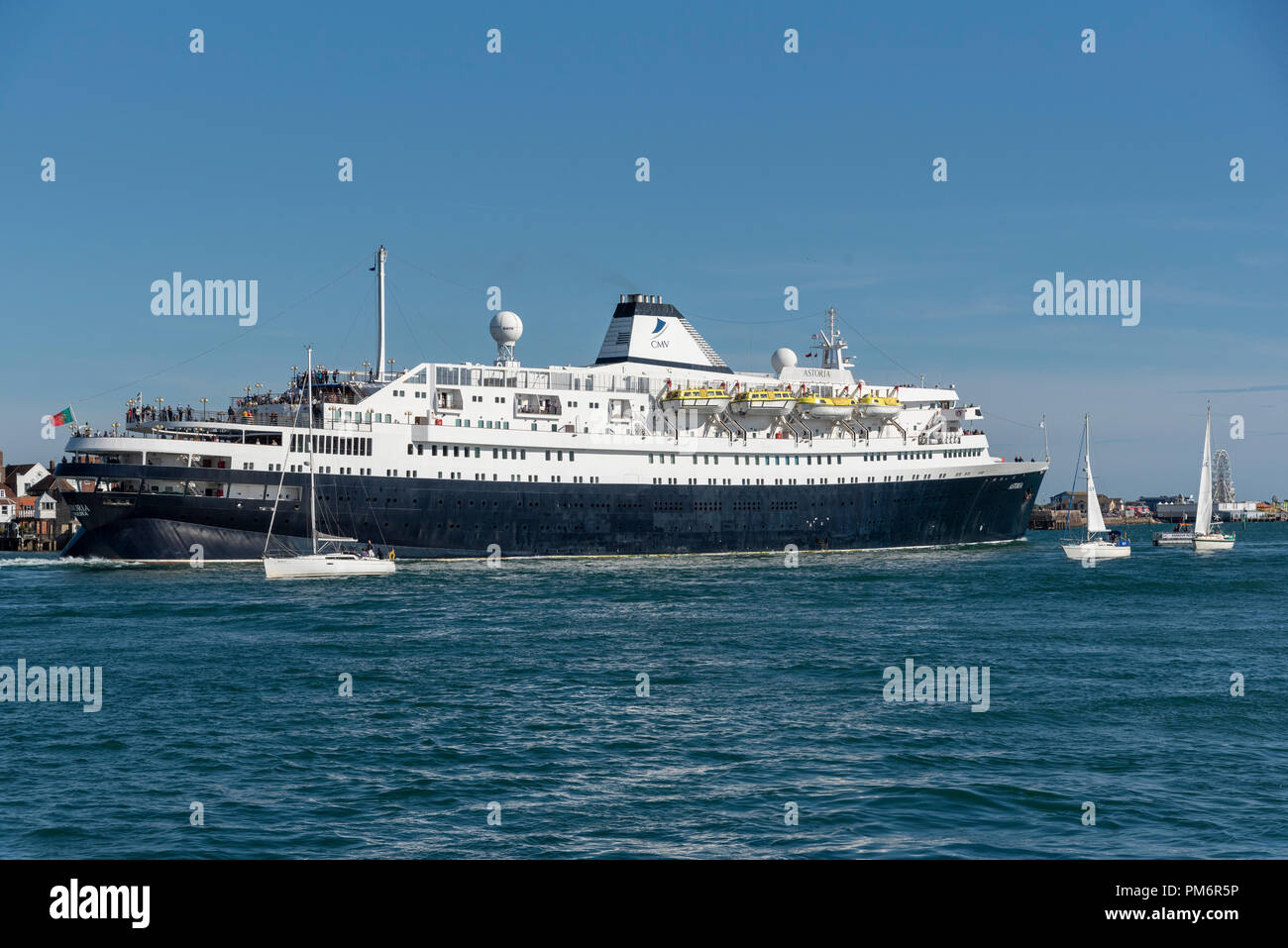 MV Astoria departing Portsmouth Harbour, England UK. She came into service in 1946 and is the second oldest cruise ship in service. - Stock Image