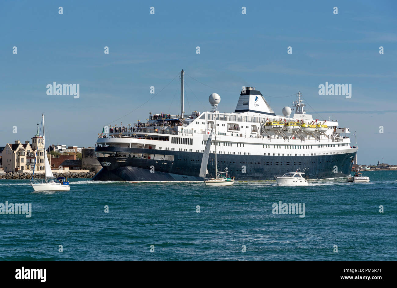MV Astoria departing Portsmouth Harbour, England UK. She came into service in 1946 and is the second oldest cruise ship in service. Stock Photo