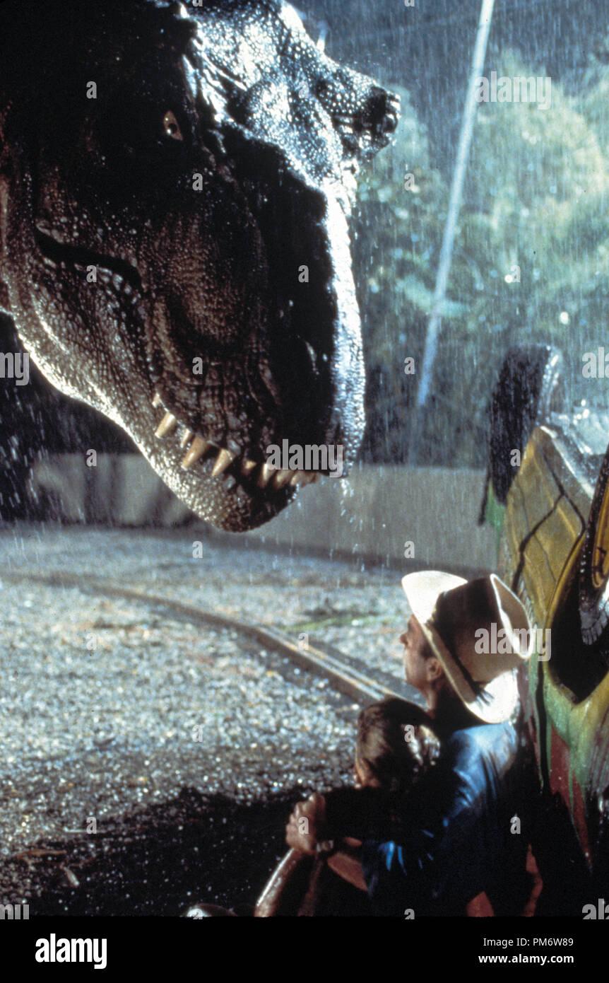 Film Still from 'Jurassic Park'  Sam Neill, Ariana Richards and dinosaur © 1993 Universal  Photo Credit: Murray Close - Stock Image