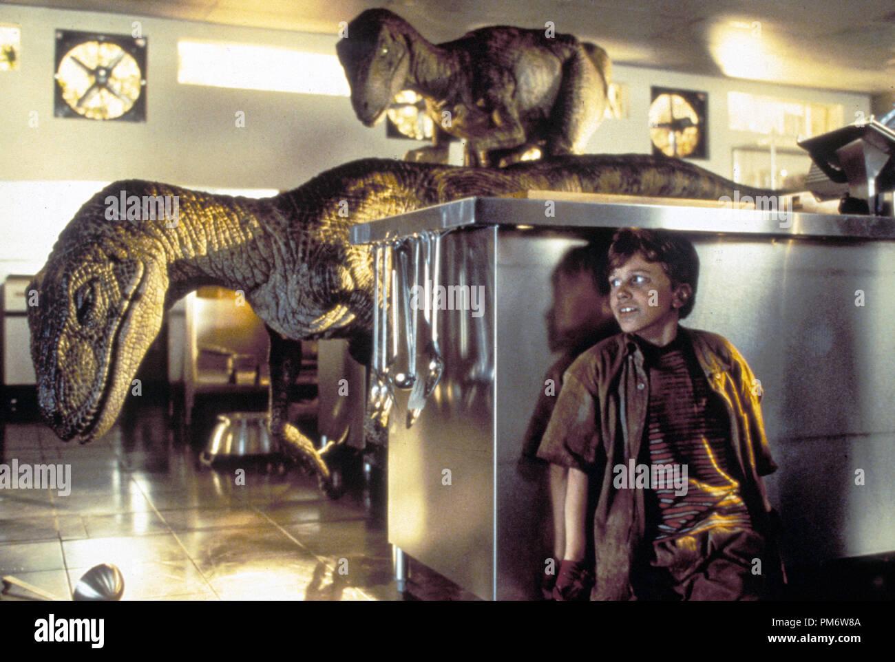 Film Still from 'Jurassic Park'  Joseph Mazzello and dinosaurs © 1993 Universal  Photo Credit: Murray Close - Stock Image