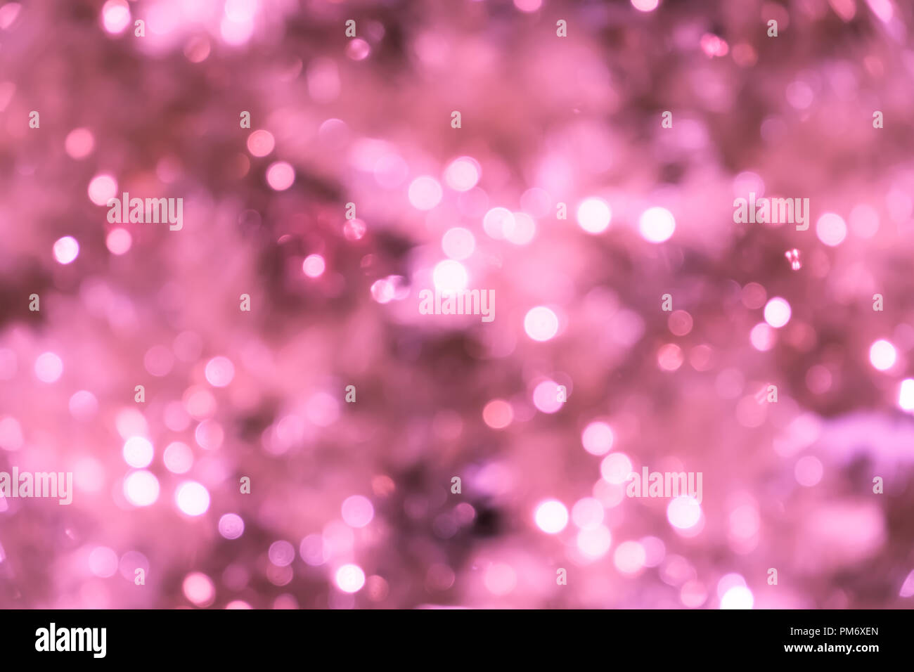 Pink Christmas Lights.Pink Blurred Background With Bokeh Lights Closeup Of Blurred