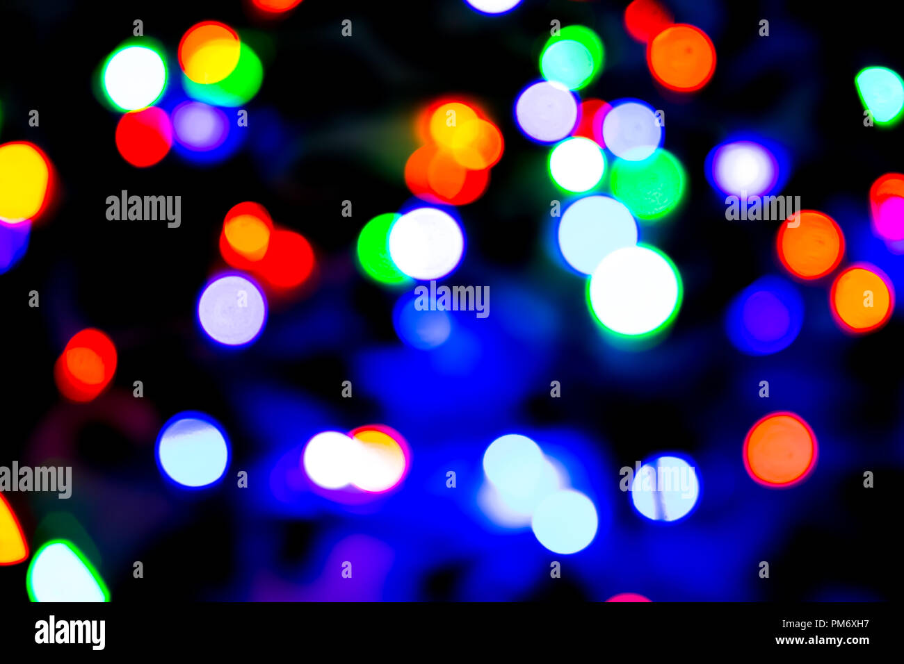 Colorful Christmas Lights Aesthetic.Blurred Background With Colorful Bokeh Lights On Dark Purple