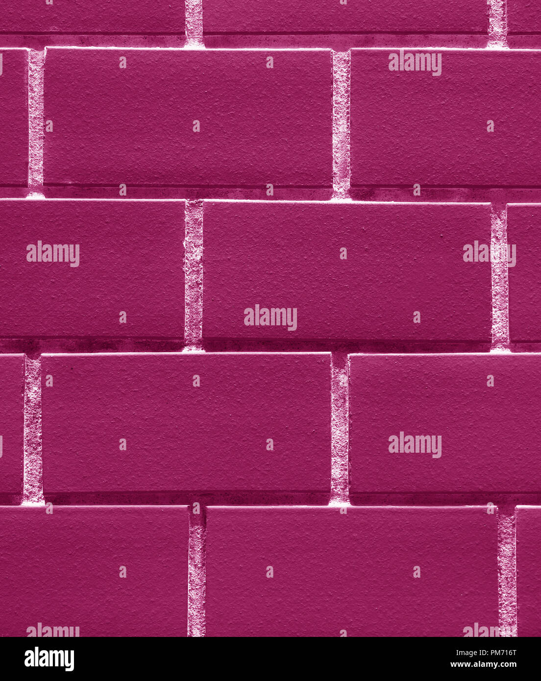 Vertical Photo of Bricks Wall in Red Purple or Magenta Color for Background, Texture, Pattern - Stock Image