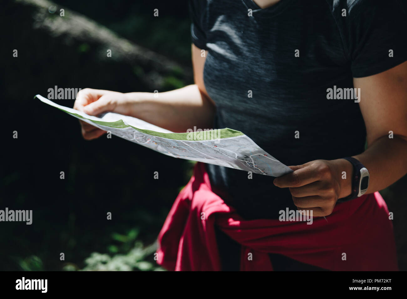 Close-up of a woman reading map orientation concept. - Stock Image