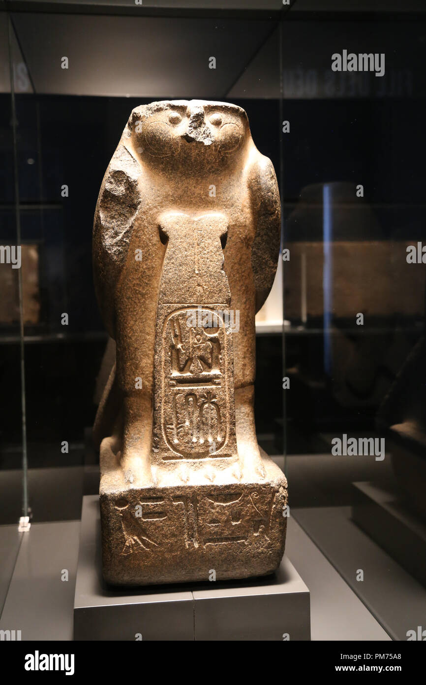 Figure of god Ra-Horakhty of a seated falcon pedestal behind a cartouche of Ramses II. 19th Dynasty. Reign of Ramese II. C. 1270BC. Tell-el-Maskhuta.  - Stock Image