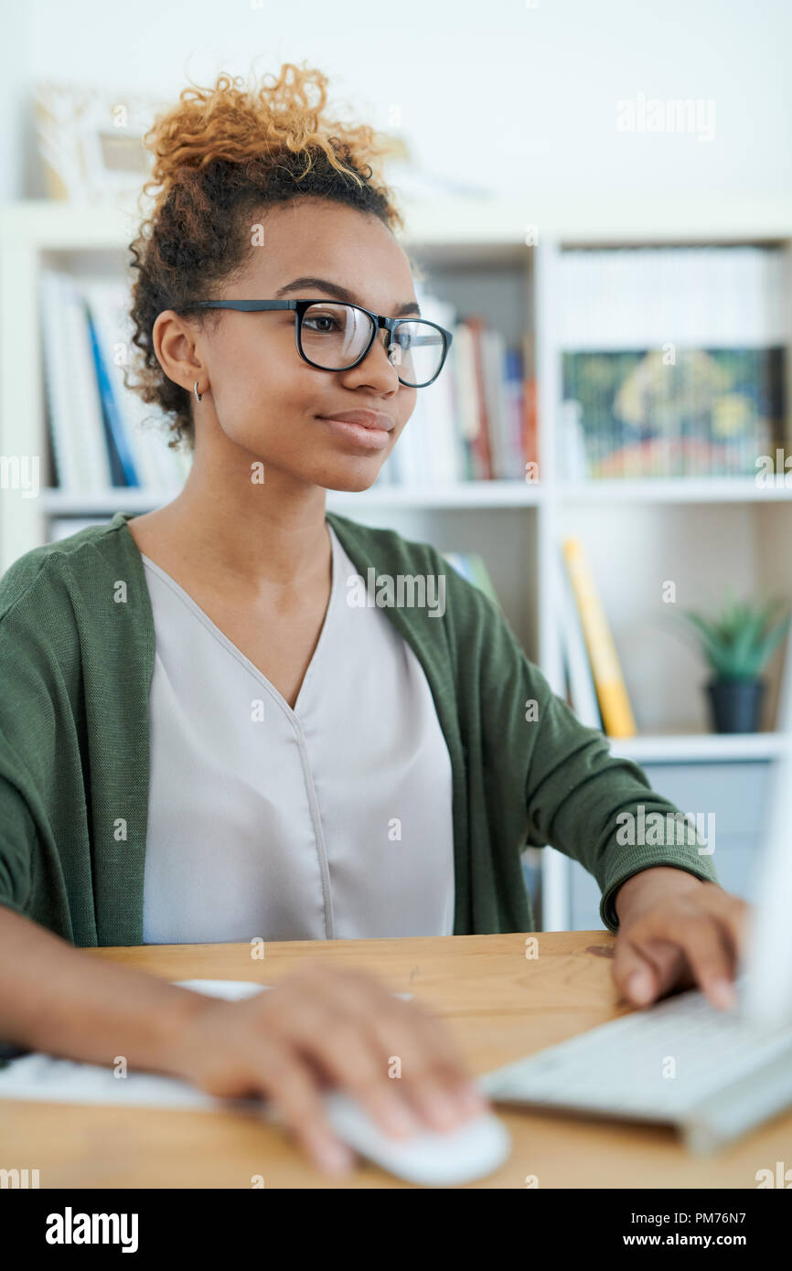 Young African-American Businesswoman at Work - Stock Image