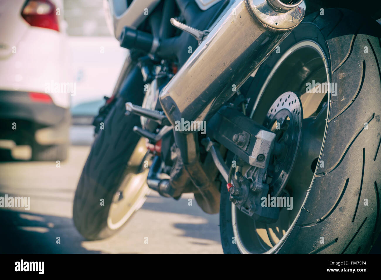 Rear view of the motorcycle. Rear wheel, exhaust pipe. - Stock Image