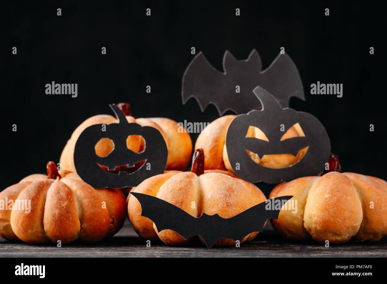 homemade halloween cakes in shape of pumpkin on dark background hallooween sweets stock image