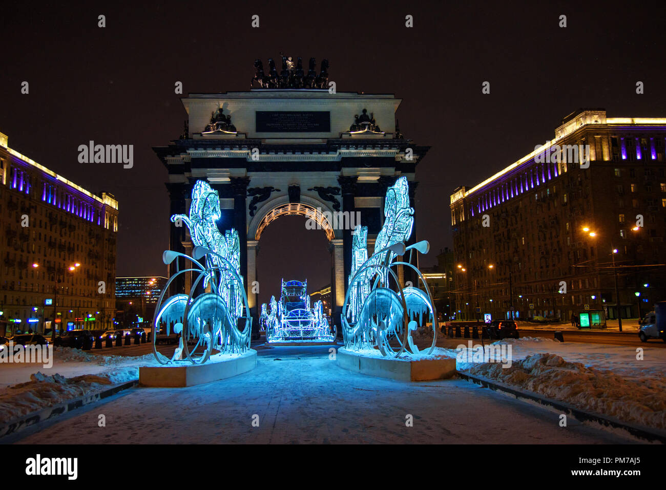 Moscow, Russia - January 29, 2018: Triumphal Arch with Christmas and New years illuminations decoration at night - Stock Image