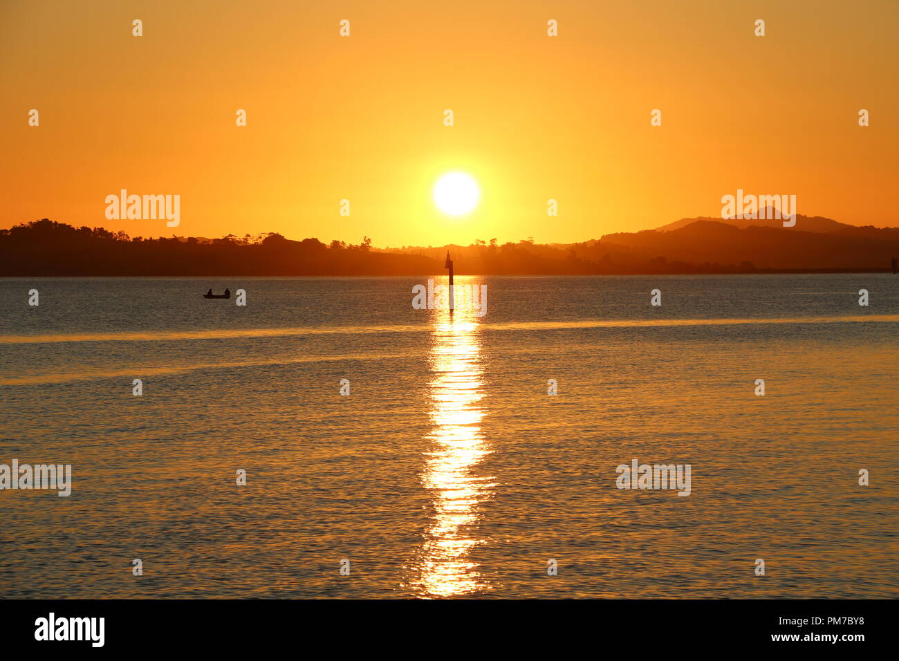 Fisching boat during sunset at Jacksons Bay - New Zealand Stock Photo