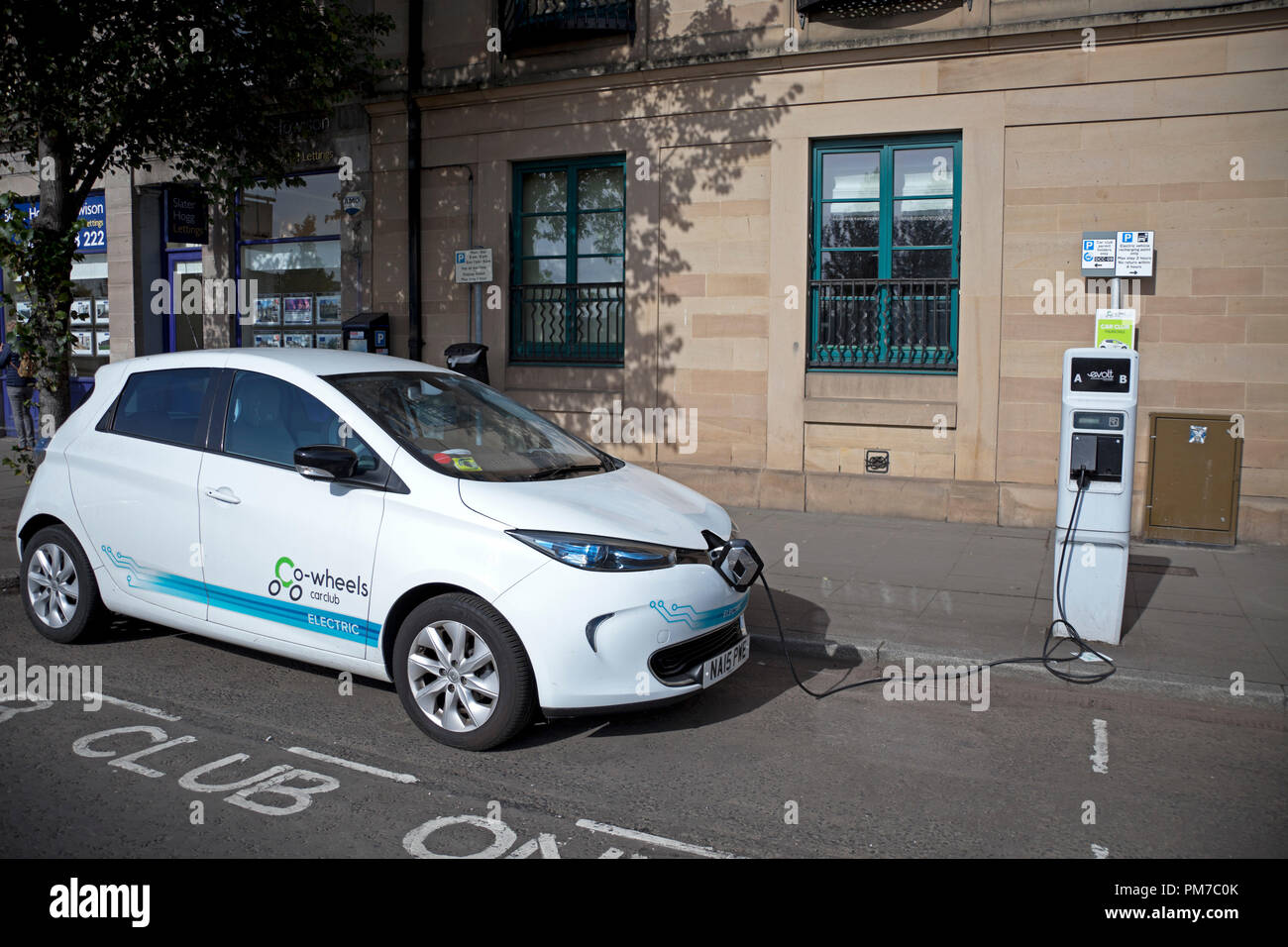 Electric car motor vehicle charging, Dundee, Scotland, UK - Stock Image