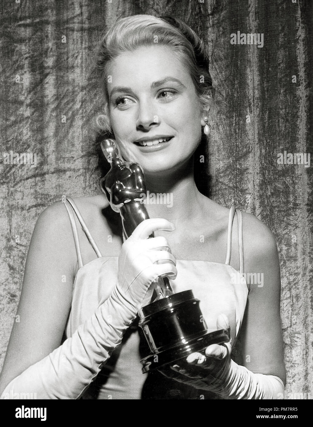 Grace Kelly holds her 'Best Actress' Oscar for her performance in 'The Country Girl' at The 27th Annual Academy Awards held at the RKO Pantages Theatre on March 30, 1955.  File Reference # 31386_439 - Stock Image