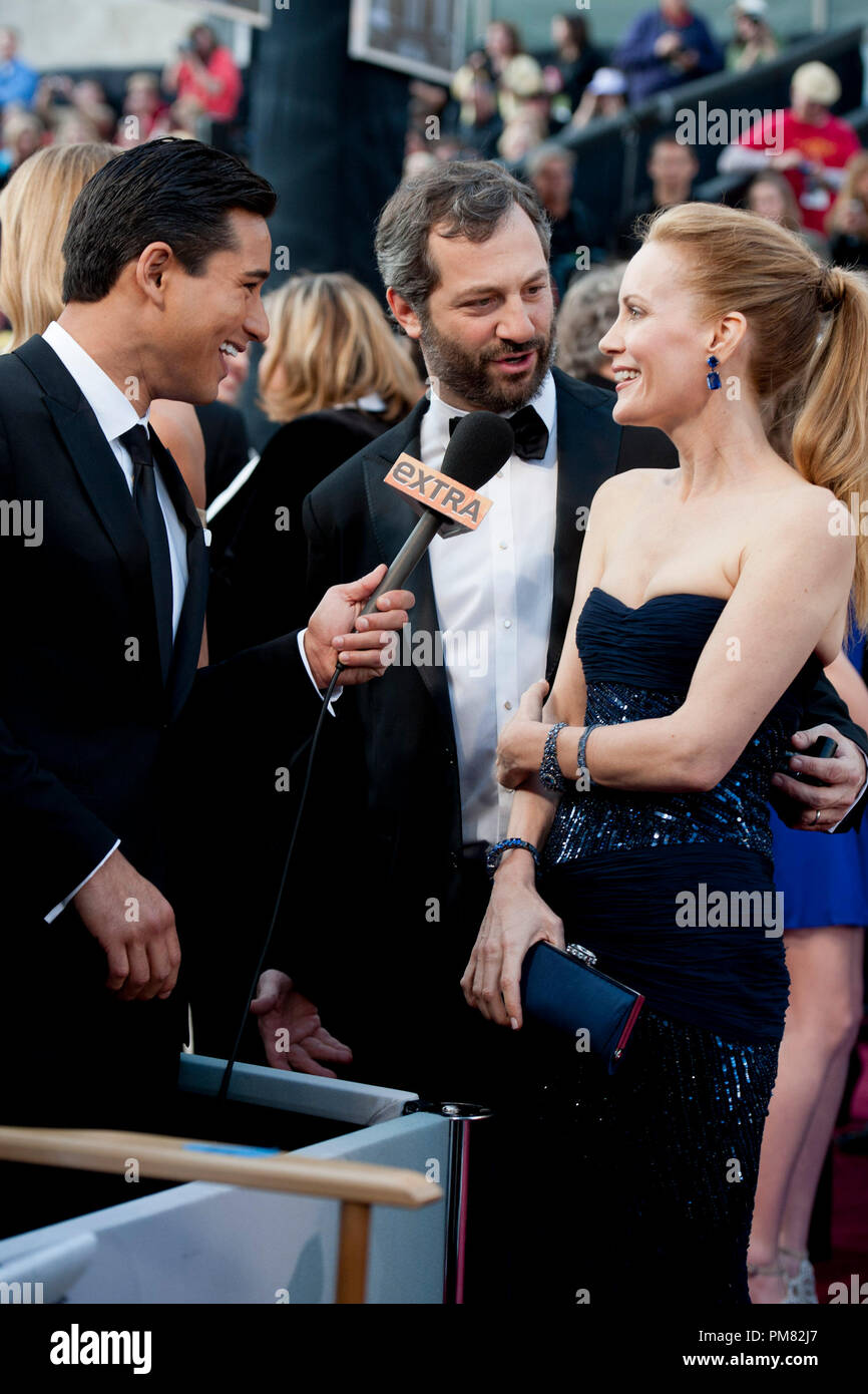 Mario Lopez interviews Judd Apatow and Leslie Mann before the 84th Annual Academy Awards from Hollywood, CA February 26, 2012. - Stock Image