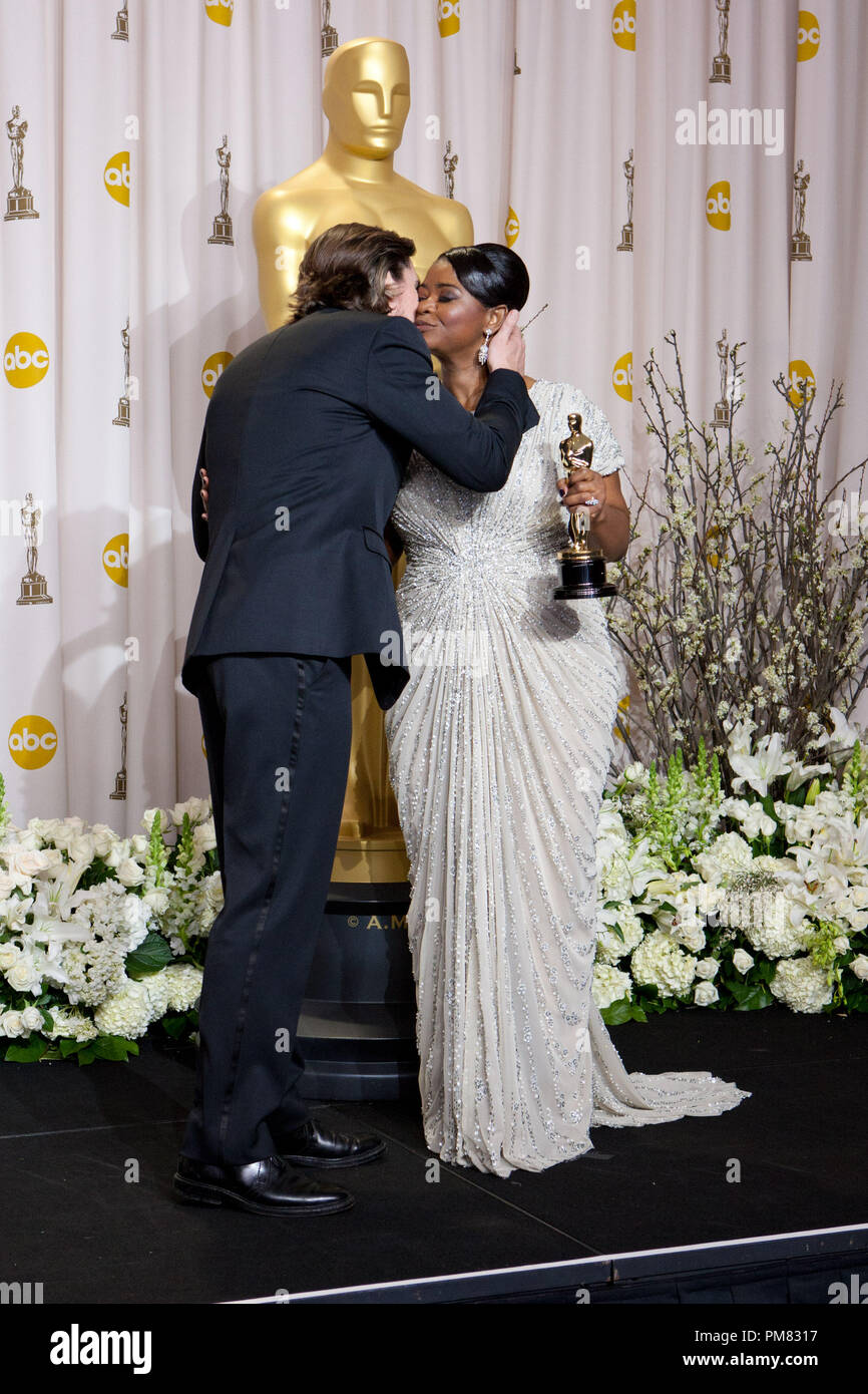 Oscar-winning actress Octavia Spencer, winner for Performance by an Actress in a Supporting Role for her role in 'The Help', is greeted by Christian Bale backstage for the media during the live ABC Television Network broadcast of the 84th Annual Academy Awards from the Hollywood and Highland Center, in Hollywood, CA, Sunday, February 26, 2012. - Stock Image
