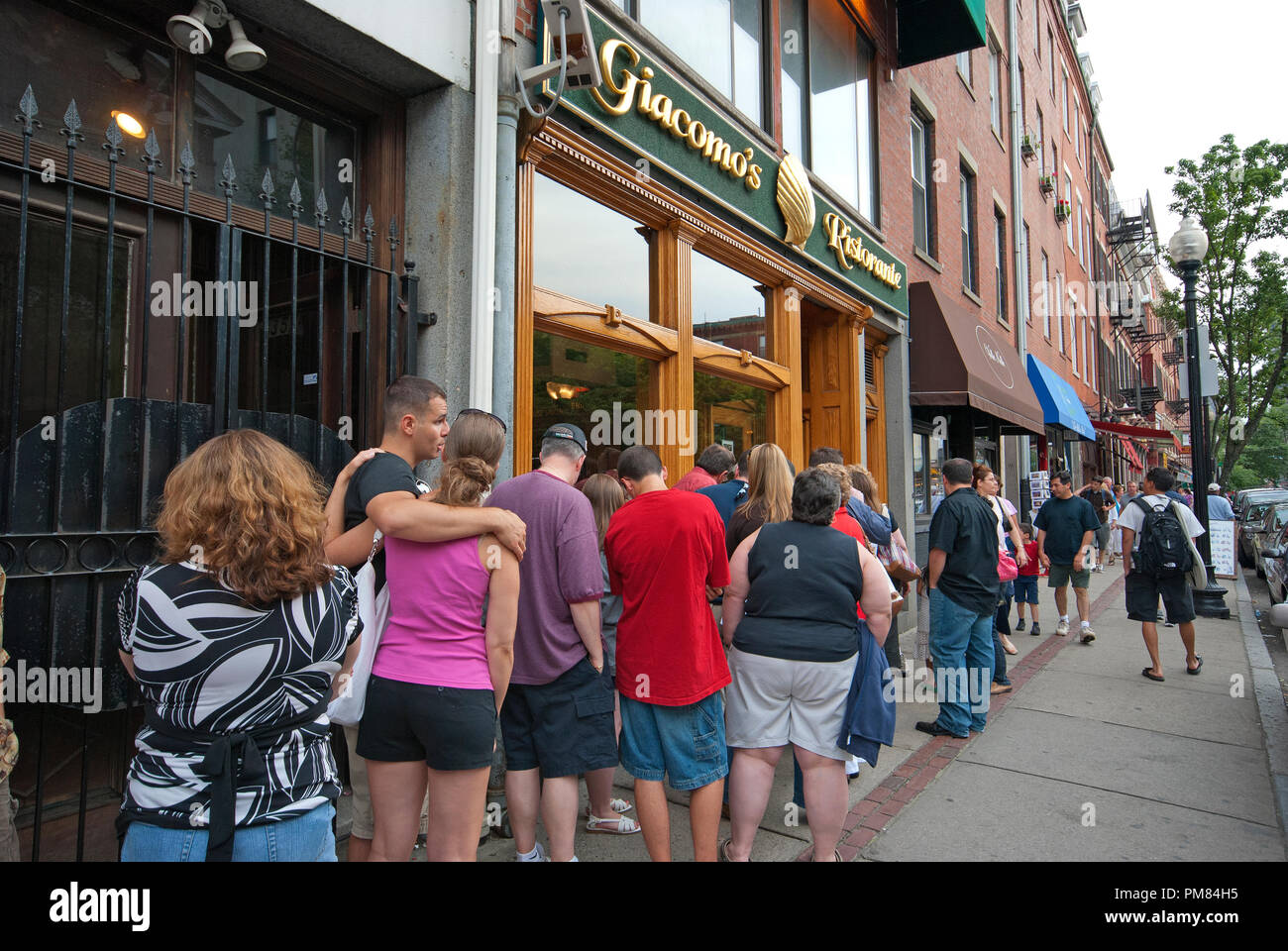 Queue Of People Outside The Famous Italian Giacomo S