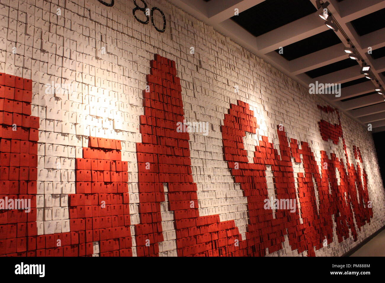 A Solidarność sign created with thousands of white and red post it notes mimicking the hearbeat seen on a life-support machine Stock Photo