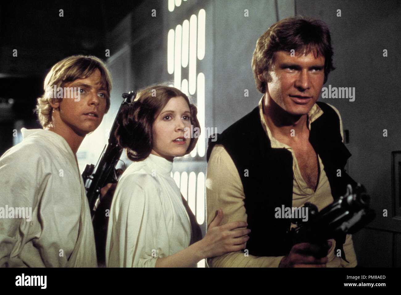 Studio Publicity Still of Harrison Ford, Carrie Fisher and Mark Hamill in 'Star Wars' 1977 20th Century Fox File Reference # 31780_705 - Stock Image