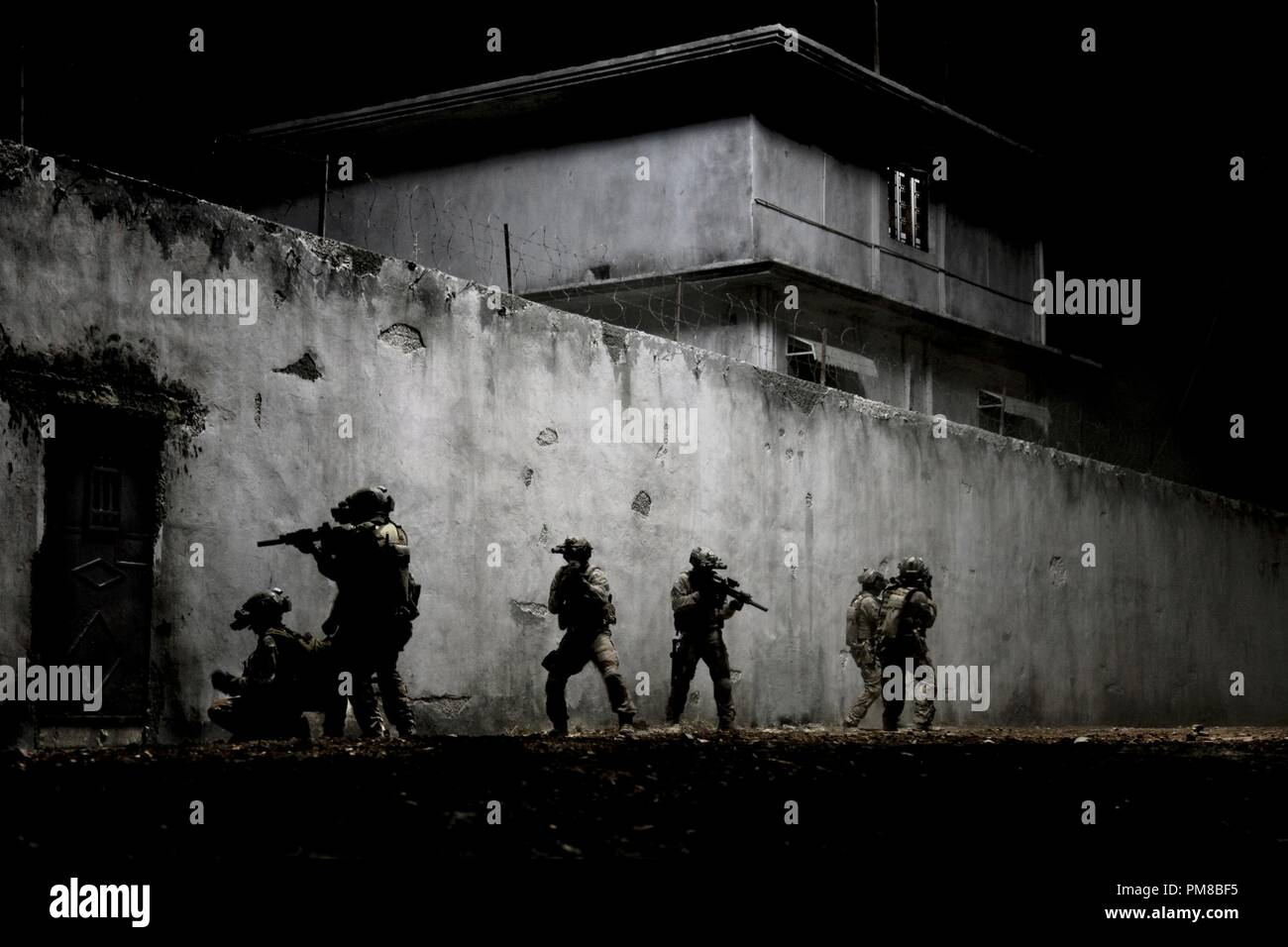 In the darkest hour of the night, elite Navy SEALs raid Osama Bin Laden's compound in Columbia Pictures'  ultra realistic new thriller about the greatest manhunt in history, ZERO DARK THIRTY. - Stock Image
