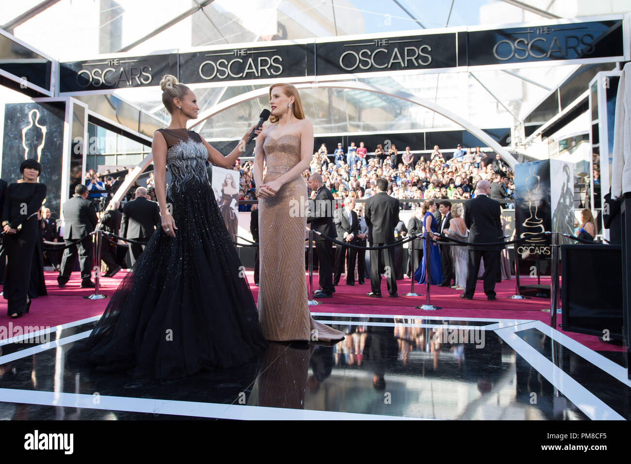 Kristin Chenoweth (L) interviews Jessica Chastain, Oscar®-nominee for Actress in a Leading Role, before The Oscars® at the Dolby® Theatre in Hollywood, CA February 24, 2013. - Stock Image