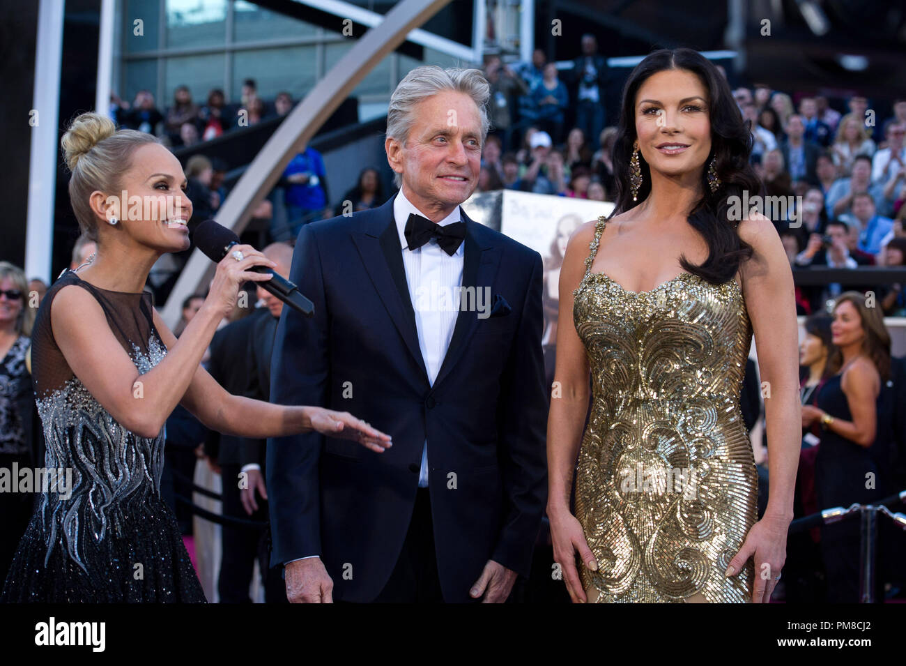 Kristin Chenoweth interviews Michael Douglas and Catherine Zeta-Jones on the red carpet for The Oscars® at the Dolby® Theatre in Hollywood, CA February 24, 2013. - Stock Image