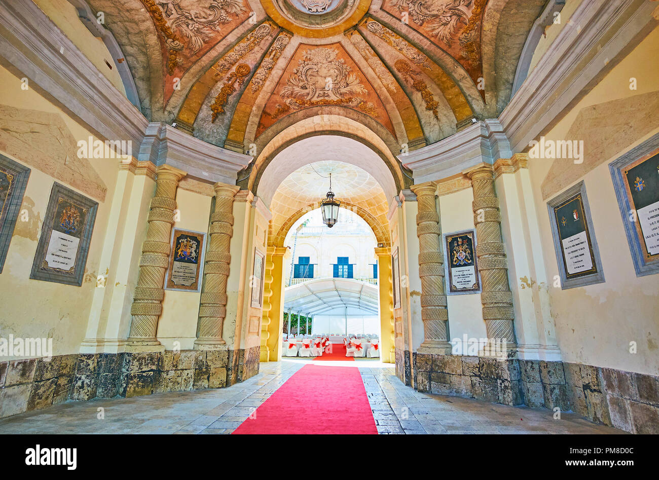 VALLETTA, MALTA - JUNE 17, 2018:  The porch's hall at the main entrance to Grandmaster's Palace with stone columns, coats of arms and beautiful dome,  - Stock Image