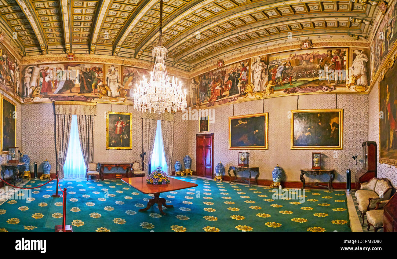 VALLETTA, MALTA - JUNE 17, 2018: The Throne Room (Supreme Council Hall) of Grandmaster's Palace decorated with carved wooden ceiling, frescoes, painti - Stock Image