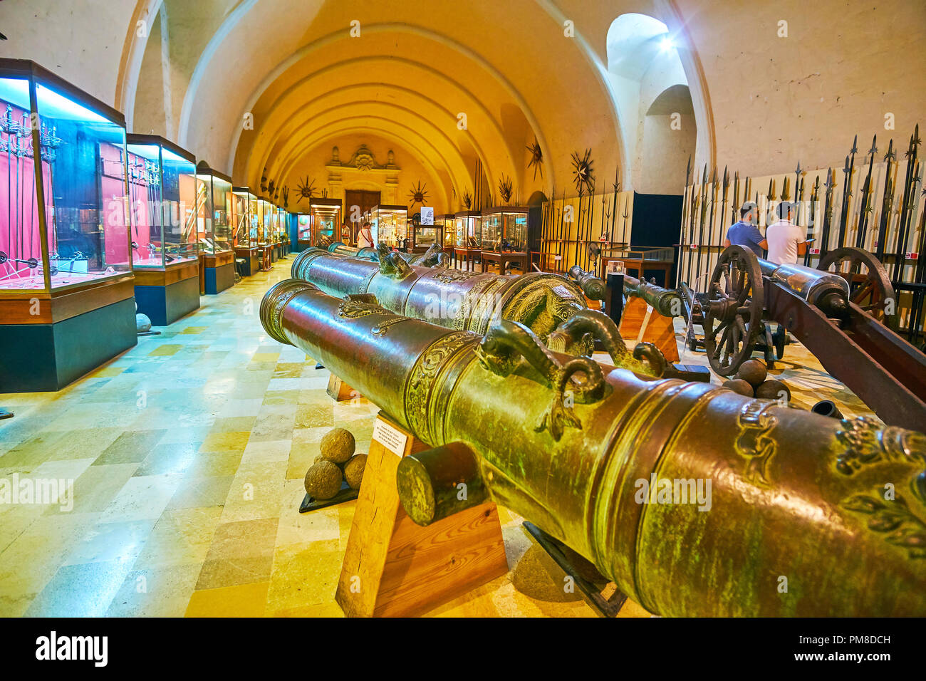 VALLETTA, MALTA - JUNE 17, 2018: Collection of old cannons and crusaders'  spears in Palace Armoury - the arsenal in rear of Grandmaster's Palace, on  - Stock Image