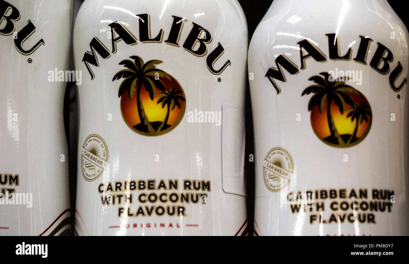 Malibu is a coconut flavored liqueur, made with Caribbean rum, and possessing an alcohol content by volume of 21.0 %. As of 2017 the Malibu brand is owned by Pernod Ricard, who calls it a 'flavored rum', where this designation is allowed by local laws. - Stock Image