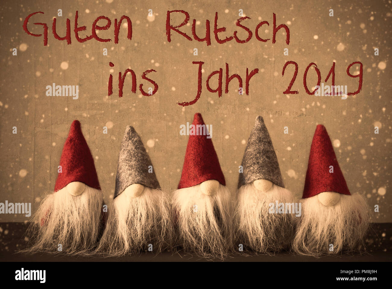 gnomes with german guten rutsch ins jarh 2019 means happy new year background with snowflakes and filter with retro style