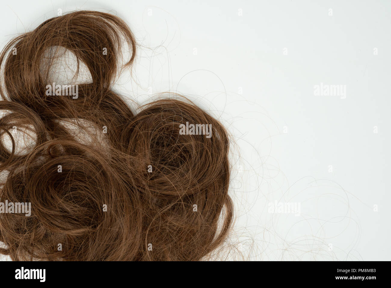 Locks of beautiful brown hair curls isolated on white background - Stock Image