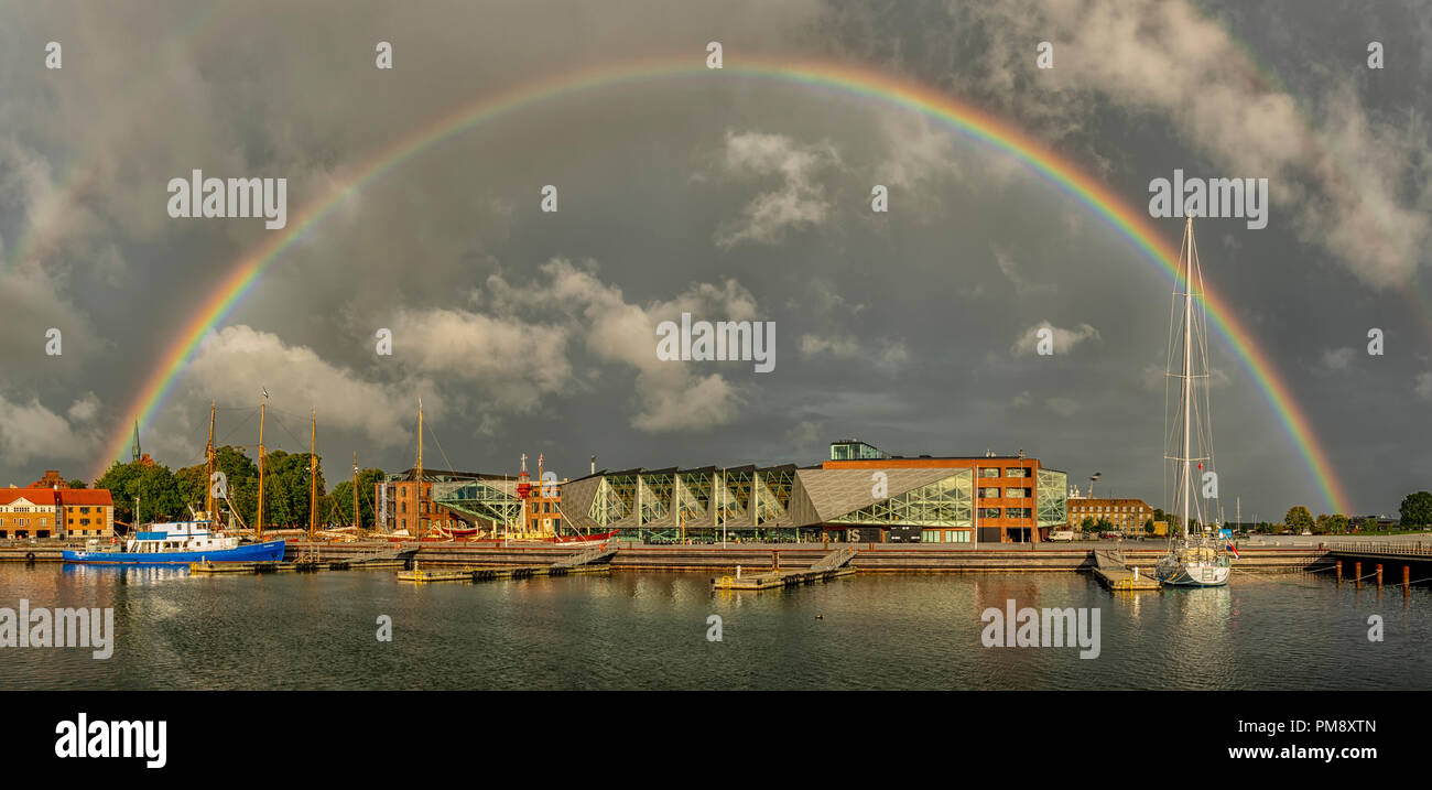 A full rainbow arcs over the art gallery in Helsingor, Denmark. - Stock Image