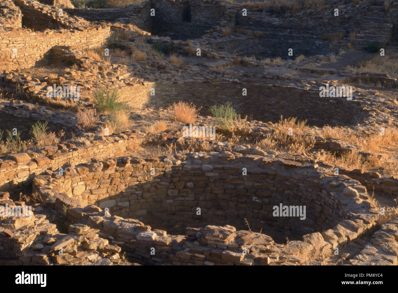 Anasazi kiva ruins of Pueblo del Arroyo, Chaco Canyon, New Mexico. Photograph - Stock Image