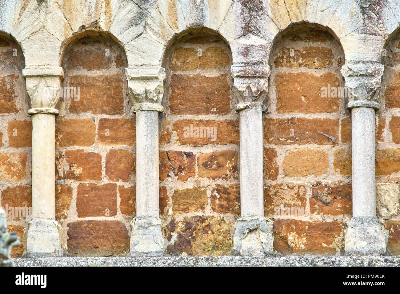 Arches on an external wall of the twelfth century norman church of St Peter, a grade 1 listed building, in the town of Northampton, England Stock Photo