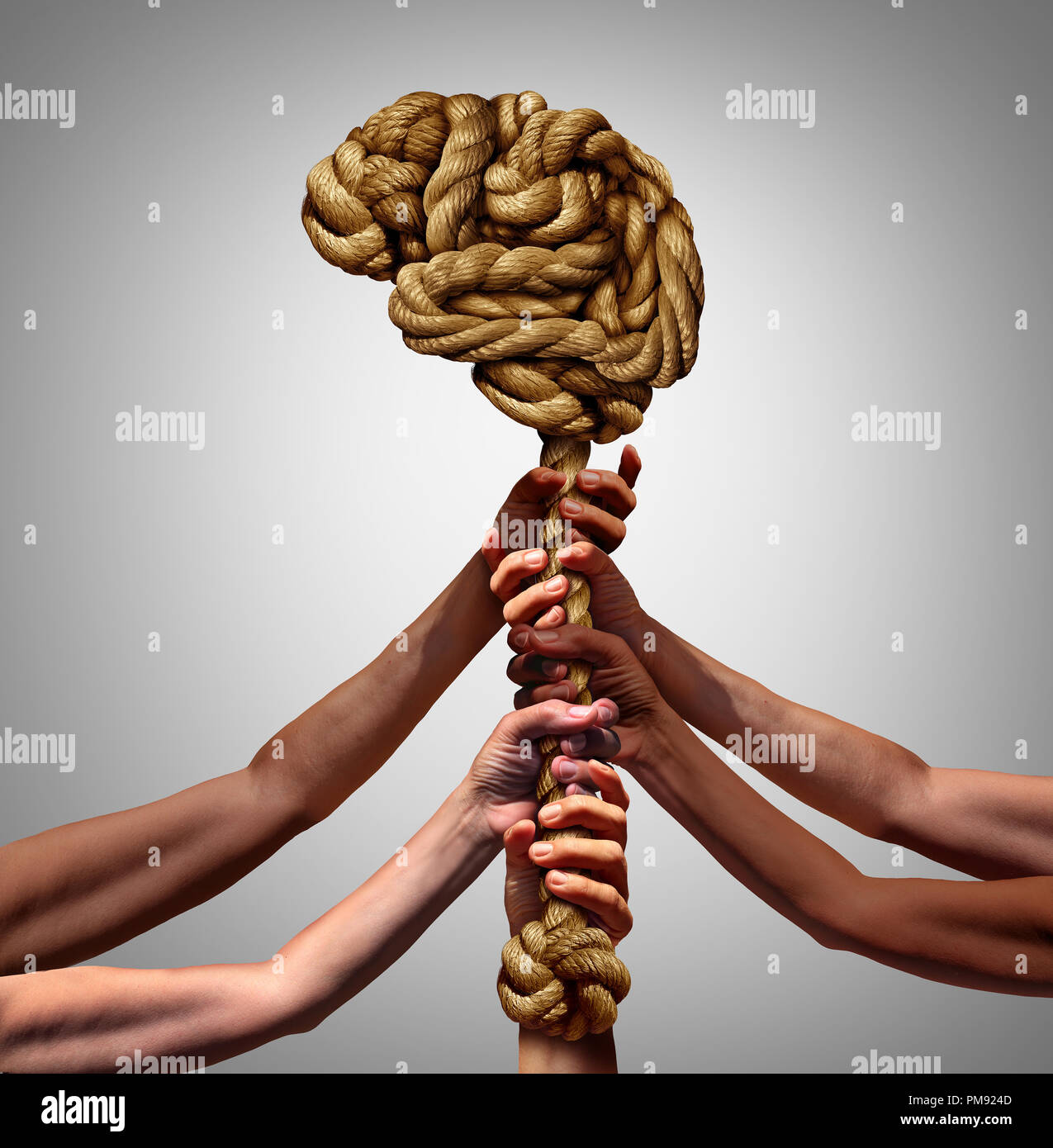 Psychology and society group mental health support concept as diverse people holding supporting a rope shaped as a thinking organ - Stock Image