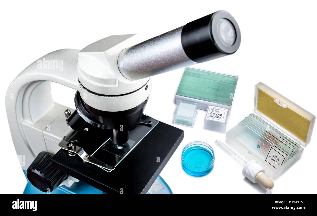 Microscopy equipment for laboratory research and medical tests, microscope with glass slides and blue liquid - Stock Image