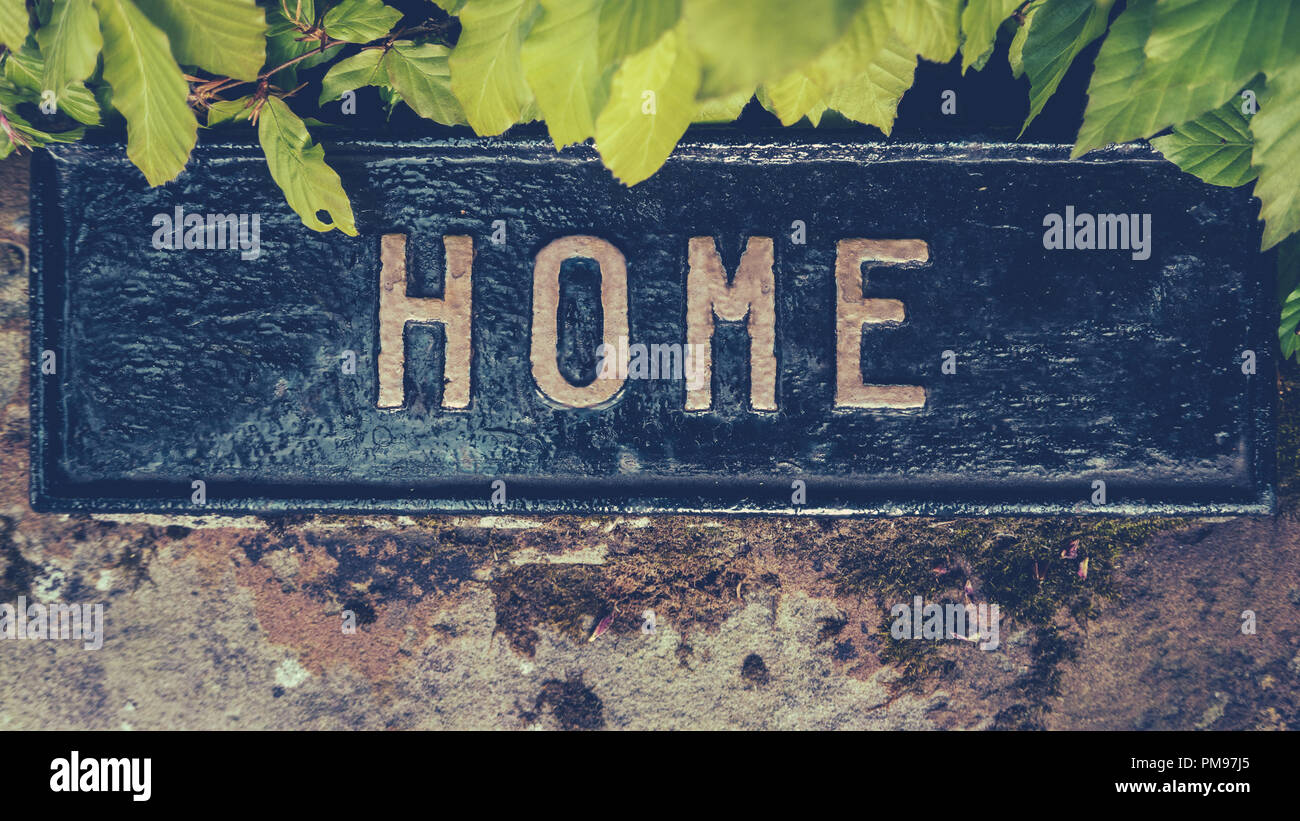 Retro Styled Image Of A Hidden Home Sign - Stock Image