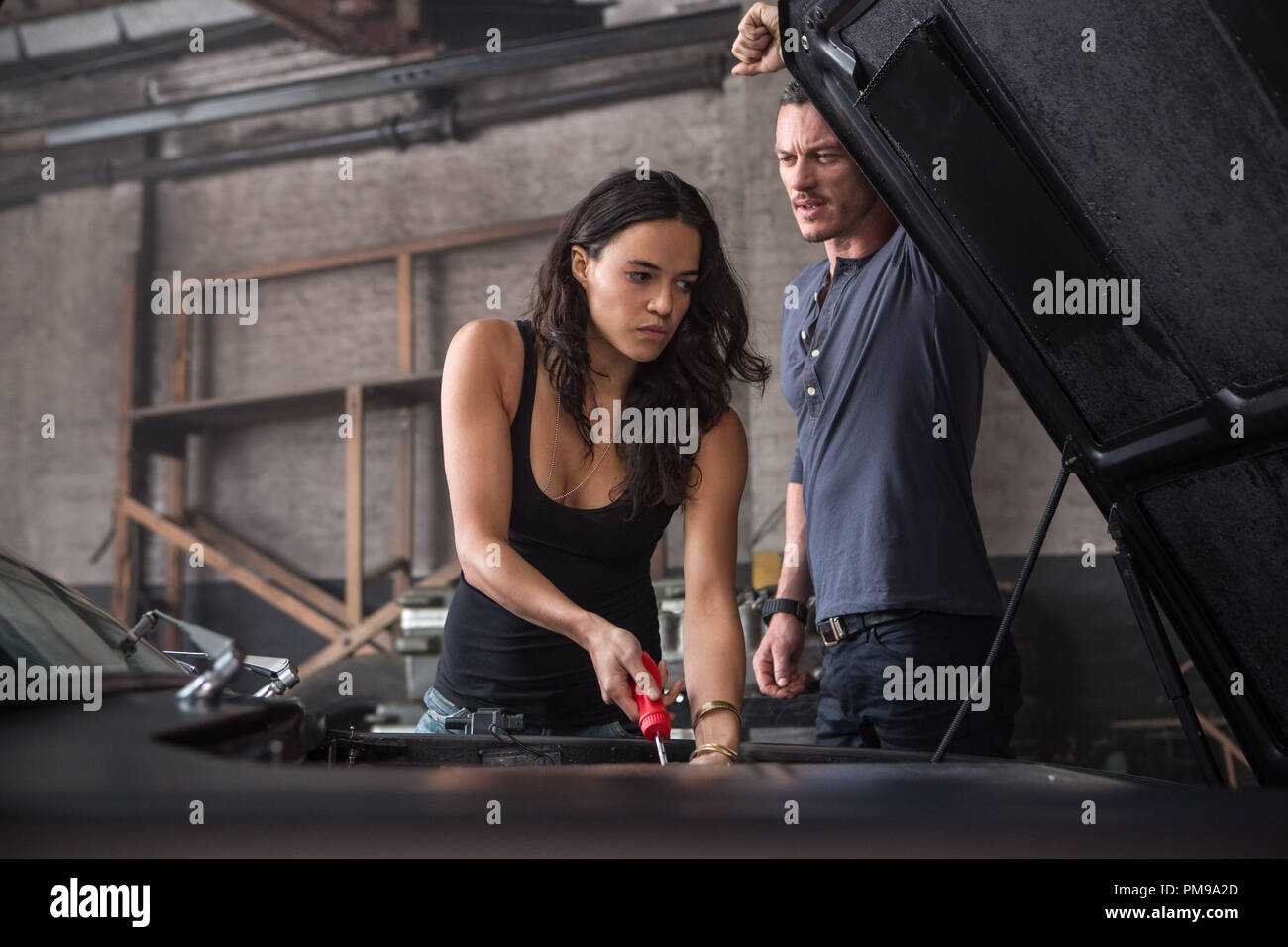 Letty (MICHELLE RODRIGUEZ) has her suspicions about Shaw (LUKE HOBBS) in 'Fast & Furious 6', the next installment of the global blockbuster franchise built on speed. - Stock Image