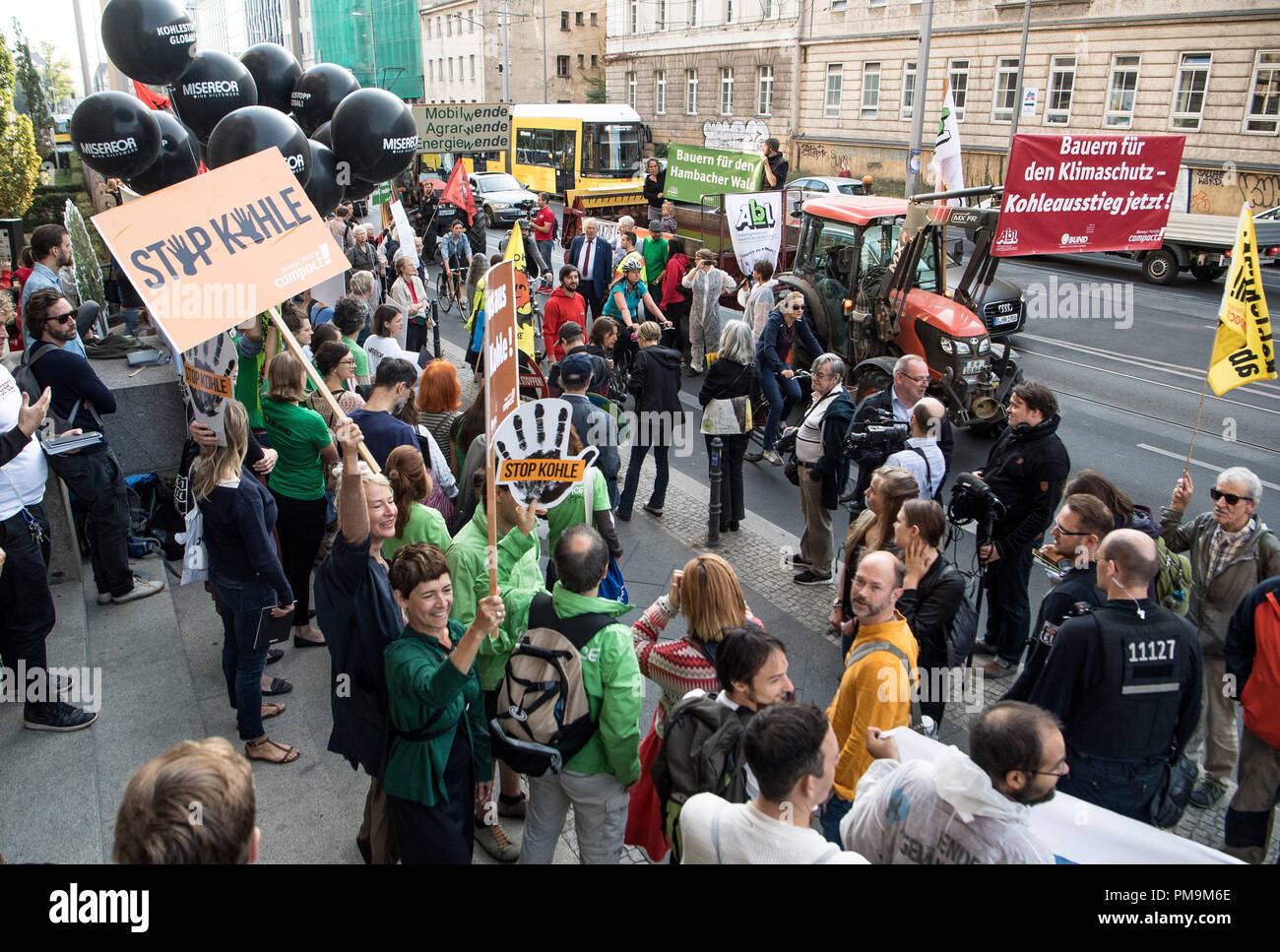 """18 September 2018, Berlin: Several demonstrators are standing in front of the Federal Ministry of Economics with banners and signs at the """"Tractor against lignite"""" campaign organised by """"Campact"""". Before today's meeting of the Coal Commission, the activists protest against the deforestation by RWE in the Hambach forest and call for the immediate phasing out of coal. Photo: Fabian Sommer/dpa Stock Photo"""