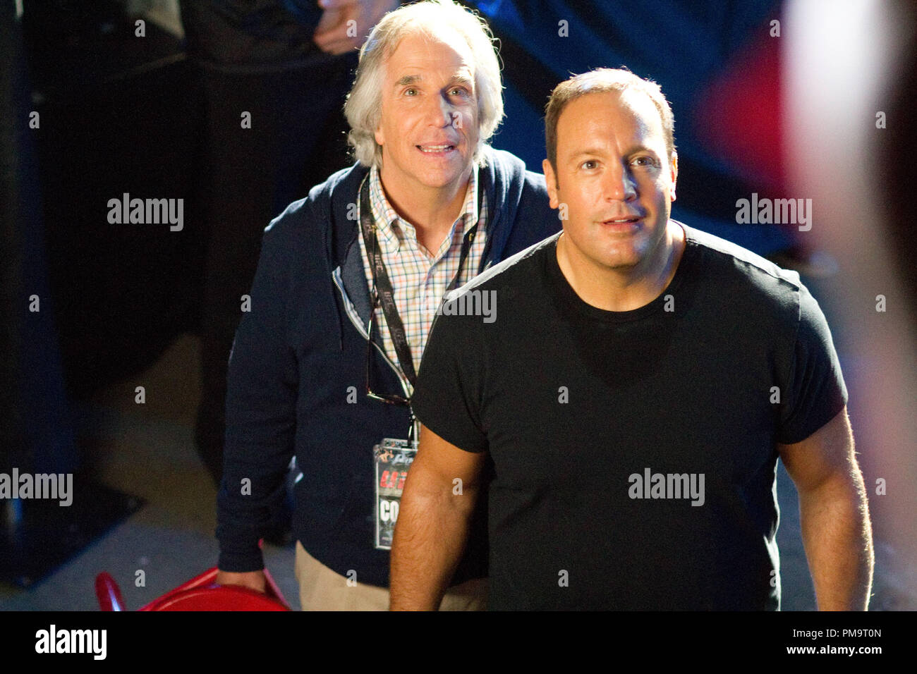 Marty (Henry Winkler) and Scott Voss (Kevin James) are stunned when they see their students' support from the stands in Columbia Pictures' HERE COMES THE BOOM. - Stock Image