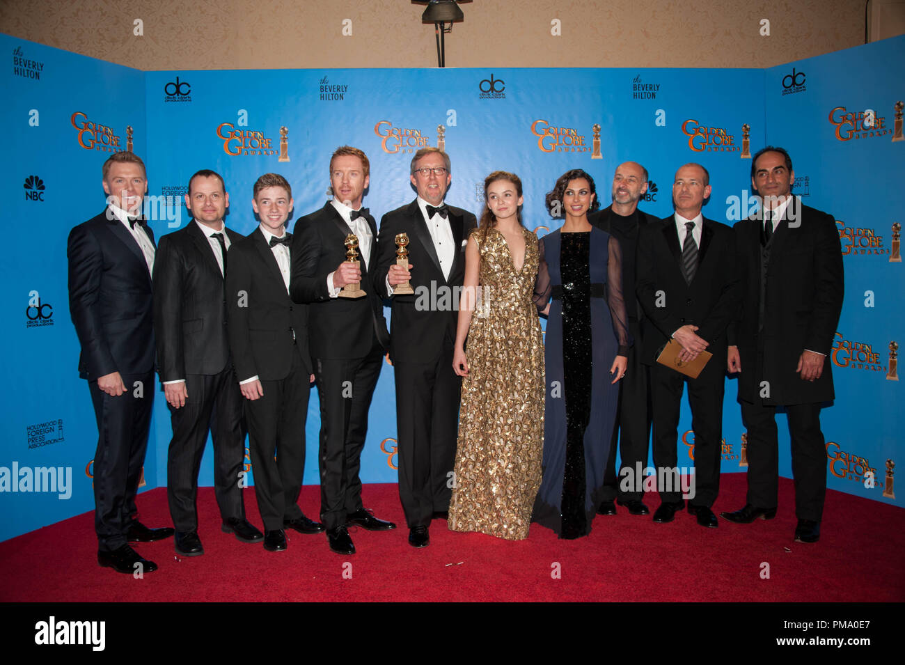 "For BEST TELEVISION SERIES – DRAMA, the Golden Globe is awarded to ""HOMELAND"" (SHOWTIME), produced by SHOWTIME, Teakwood Lane Productions, Cherry Pie Productions, Keshet, Fox 21. Diego Klattenhoff, Gideon Raff, Jackson Pace, Damian Lewis, Alex Gansa, Morgan Saylor, Morena Baccarin, David Marciano, Howard Gordon, and Navid Negahban pose with the award backstage in the press room at the 70th Annual Golden Globe Awards at the Beverly Hilton in Beverly Hills, CA on Sunday, January 13, 2013. - Stock Image"
