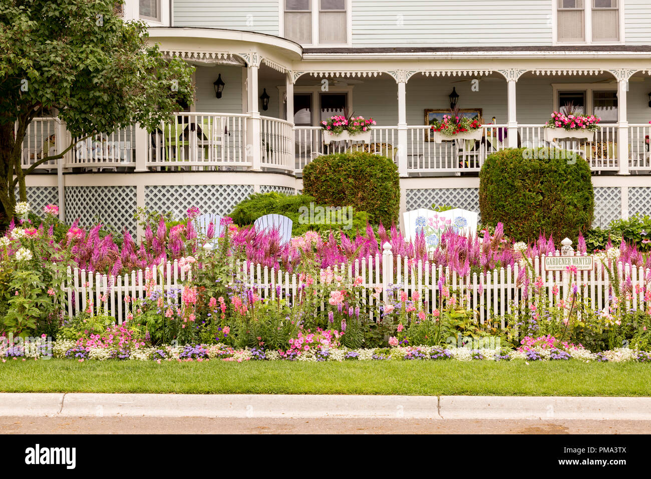 Quaint Bed And Breakfast Surrounded By Flower Gardens On Mackinac