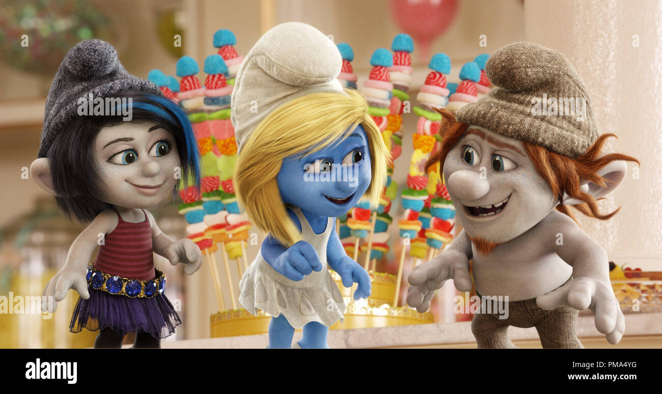 (Katy Perry) is surrounded by Gargamel's naughty creations Vexy (left, Christina Ricci) and Hackus (right, J.B. Smoove) in a candy store in Paris, France in Sony Pictures Animation SMURFS 2. - Stock Image
