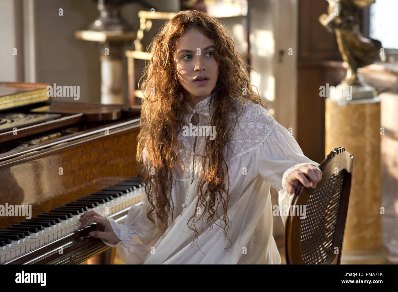 JESSICA BROWN FINDLAY as Beverly Penn in Warner Bros. Pictures' and Village Roadshow Pictures' romantic fantasy adventure 'WINTER'S TALE,' distributed worldwide by Warner Bros. Pictures and in select territories by Village Roadshow Pictures. - Stock Image